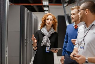 Lady and guy meeting in data center.JPG