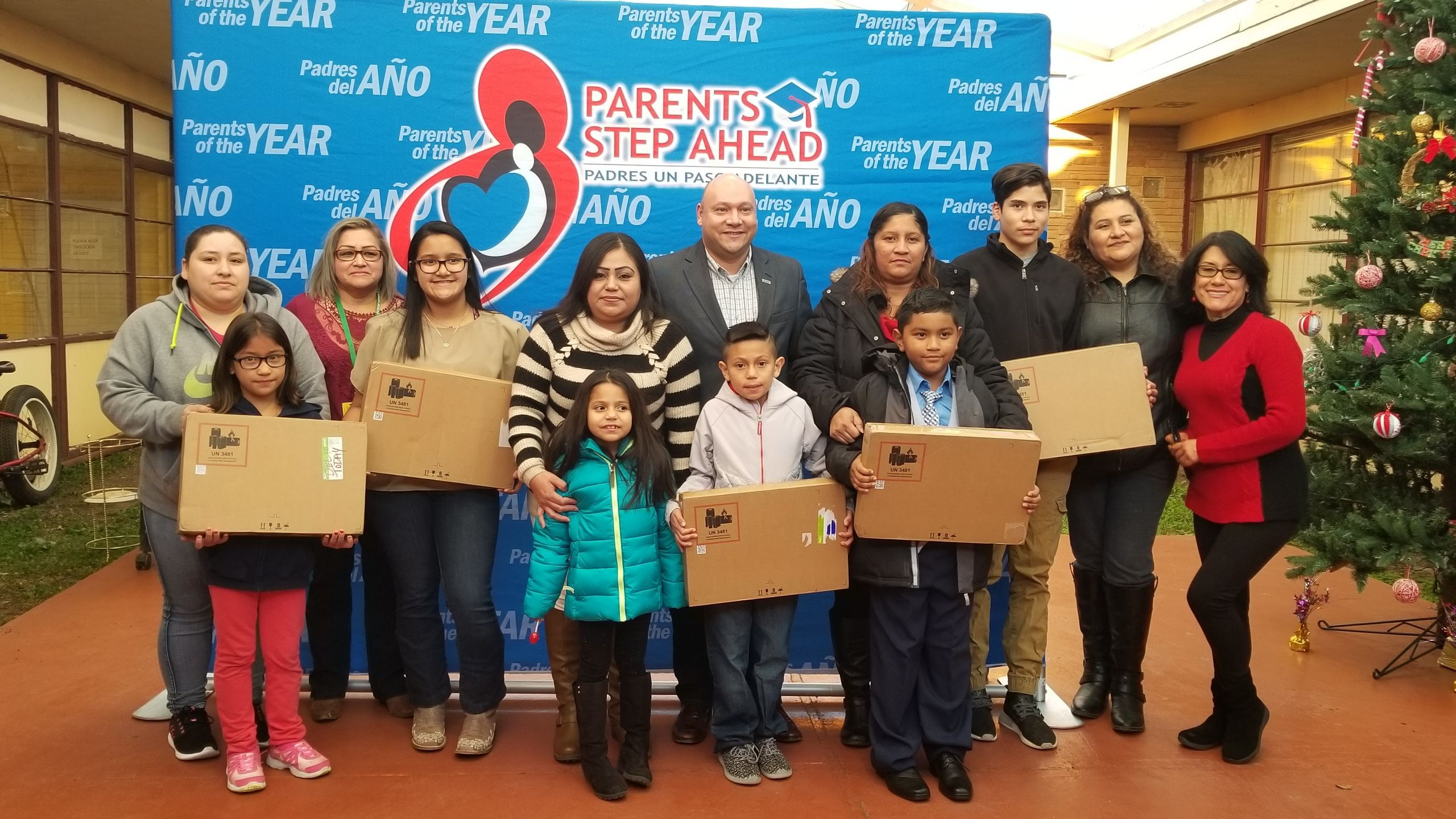 """Jesse Cortez, Global Inclusion Effectiveness Lead at HPE celebrates with """"Parents of the Year"""" and rewards students by donating laptops."""
