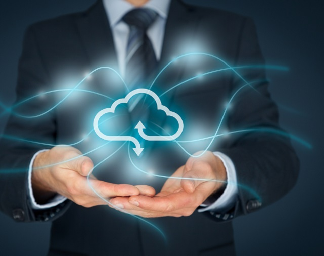 Man in suit holding virtual cloud icon