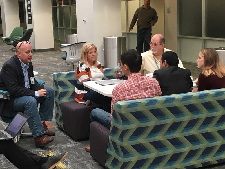 Students meeting with Keith Miracle, Kathryn McQueen and Adrian Salinas.