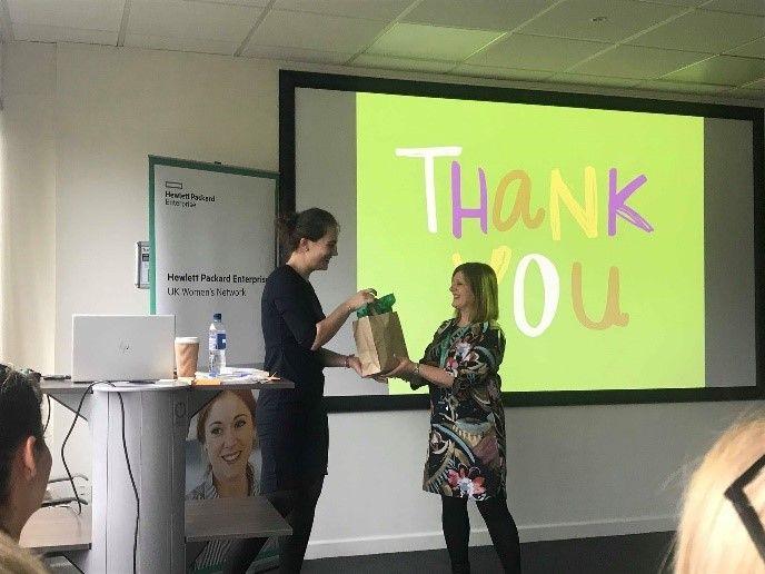 Marian Edwards providing a thank you gift to Plamena Solakova for her presentation on Self Confidence