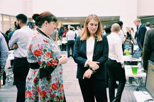 Annabel Sweeney (in business suit) sharing insight at the Houston HPE Intern Project Fair