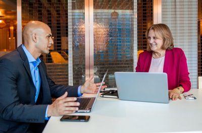 meeting, 2 peeps, 2 laptops.jpg
