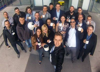 Dimitar's team taking a selfie in front of the office