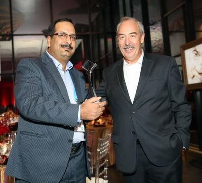 Sanjay receiving the Technology Services Leader of the year Award from Jean Paul, SVP Technology Services at Technology Services Summit, San Jose, California