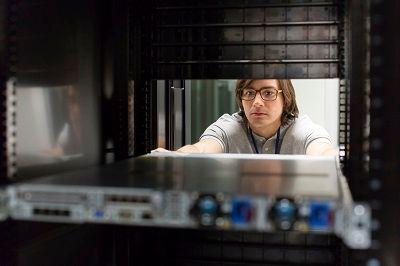Man_working_HPE_data_center.jpg