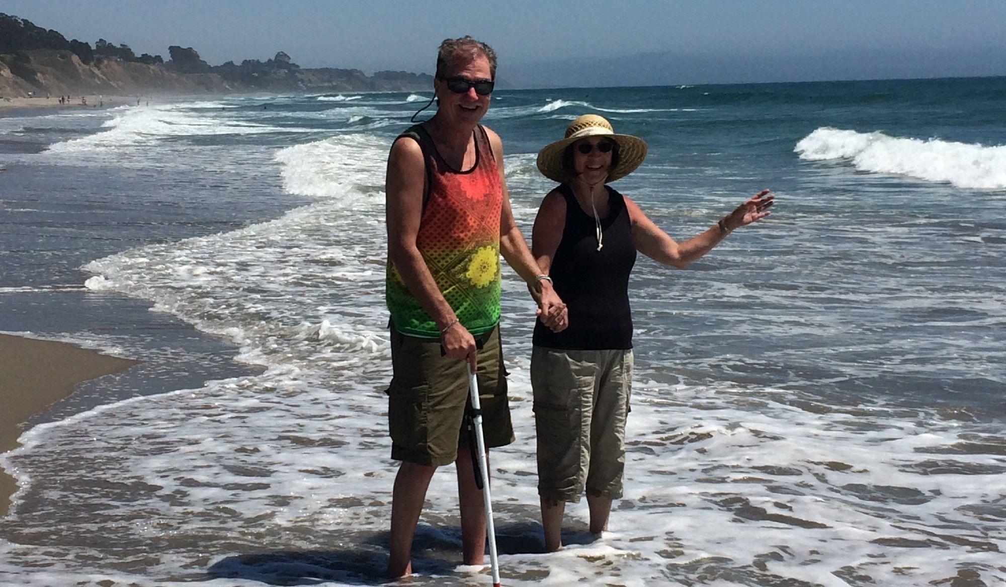 Photo of Bill and Kathy walking down the beach enjoying the ocean breeze.jpg