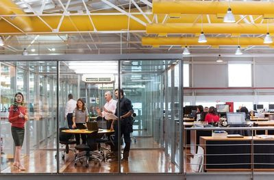 many peeps in glass office.jpg