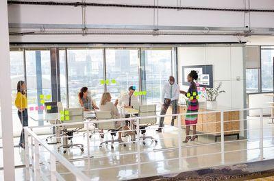 many people in glass office.jpg