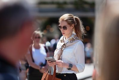 w looking at phone - outside.jpg