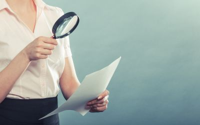bigstock-Woman-Uses-Magnifying-Glass-To-106079444.jpg