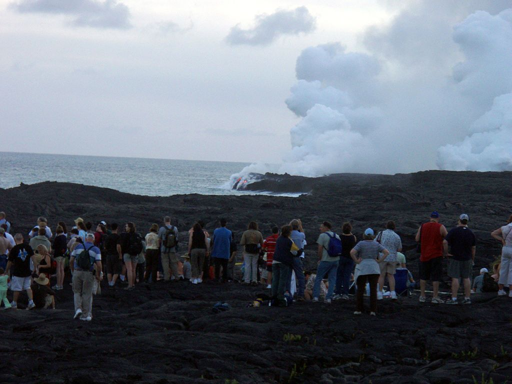 1024px-Tourists_are_looking_at_Waikupanaha_lava_ocean_entries.jpg
