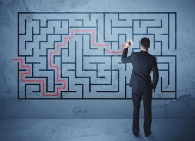 bigstock-Businessman-finding-the-soluti-142817585.jpg