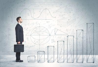 bigstock-Business-man-climbing-up-on-ha-80507984.jpg