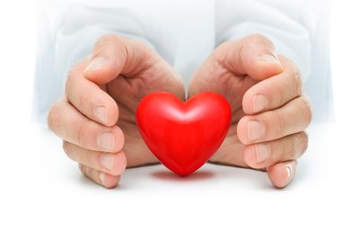 bigstock-Heart-At-The-Human-Hands-53101321.jpg