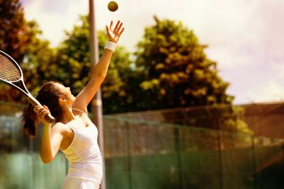 bigstock-Rear-view-of-tennis-player-ser-135385091.jpg