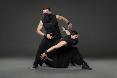 bigstock-Two-Male-Dancers-Posing-In-Nin-136185341.jpg