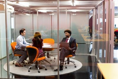 3 peeps in glass office.jpg