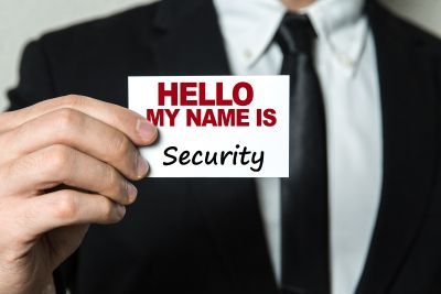 bigstock-Business-man-holding-a-card-wi-136107953.jpg