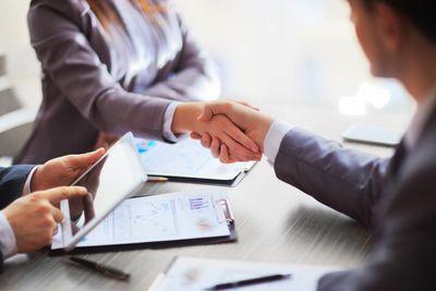 bigstock-Business-people-shaking-hands-83445530.jpg