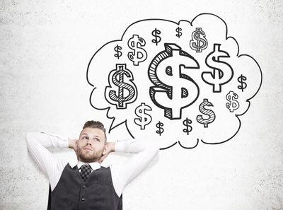bigstock-Man-Daydreaming-About-Money-139263755.jpg
