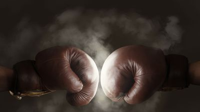 bigstock-Two-Old-Brown-Boxing-Gloves-Hi-134955308.jpg