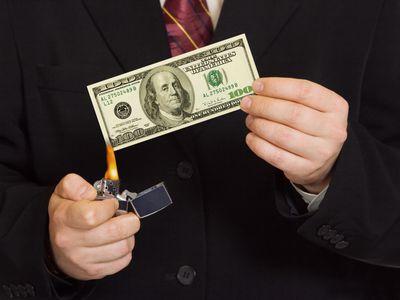 bigstock-Hands-And-Burnning-Money-50770388.jpg