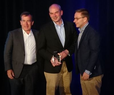 Pierre Mirlesse (Vice President for Health, Public Sector and Global Industries, HPE EMEA) collects the EMEA award from Jean-Philippe Barleaza (VP, Channel, Alliances and General Business, VMware EMEA) and Jean-Pierre Brulard (SVP and GM, VMware EMEA)