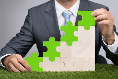 bigstock-Businessman-Holding-Jigsaw-Gra-77089382.jpg